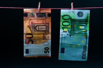 euro bills on a rope with clothespins