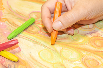 Drawing hand with crayons
