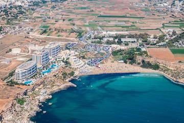 Aerial view of Golden bay beach, Ghajn Tuffieha bay. Mellieha (Il-Mellieħa), Northern Region, Malta island. Malta from above.