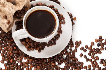 A Cup of strong coffee and a textile bag in roasted coffee beans, on a white background, isolated