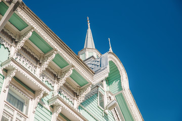 Wooden house with carving against the blue sky, Tomsk, Russia