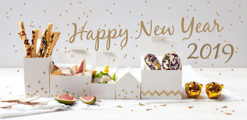 Happy New Year - white table with food snacks