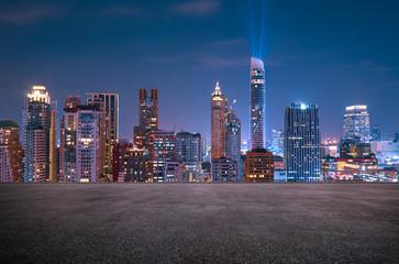 Fotomurales - Bangkok urban cityscape skyline night scene with empty asphalt floor on front
