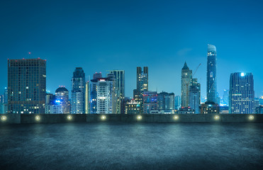 Fotomurales - Bangkok urban cityscape skyline night scene with empty top floor on front