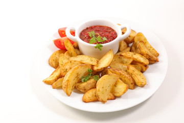 french fries and tomato sauce on white background