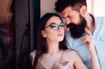 Fashion is part of our culture. Couple in love. Couple of lovers with fashion style. Girlfriend and boyfriend in relations of friendship. Sexy woman and bearded man in love relations. Fashion models