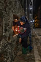 fun boy plays in the dark with an old headlamp