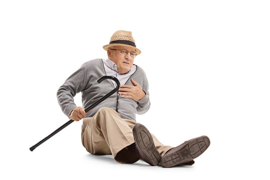 Elderly man on the ground having a heart attack