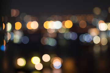 Defocused city night light blurred with bokeh abstract background.
