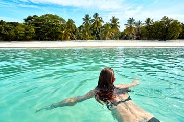 woman swimming at the beach nosy iranja