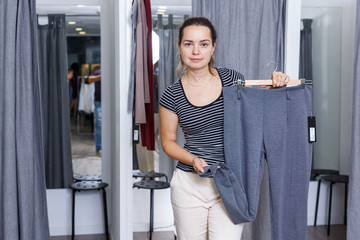 Woman trying clothes in fitting room
