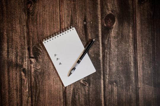 list in notebook, shoping list, to do list, goals list, wish list, idea list, pen for writting