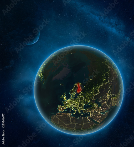 Finland at night from space with Moon and Milky Way