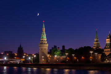 Night view of moscow kremlin with moon in the sky
