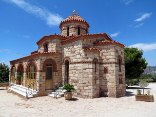 Europe, Greece, near Loutraki there are many  Christian churches. They are especially beautiful  on a bright summer day.