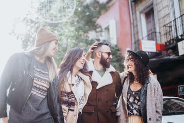 Group of friends on the street walking around having fun