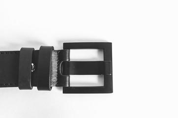 Black leather strap on white background