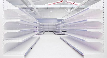 Grocery store interior with empty shelves.