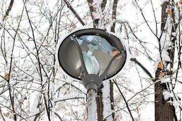 Lamp light post broken park snowfall vandalism