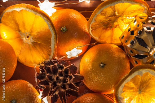 Close Up Fresh Mandarins And Dried Oranges With Cone And Lights Of