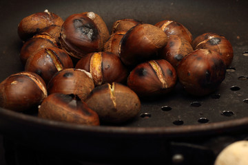 Roasted Chestnuts on a drilled Skillet, closeup view