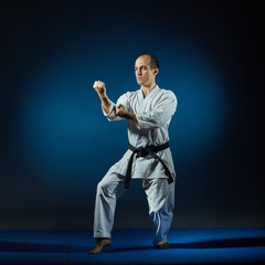 Active man doing formal karate exercises