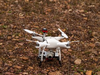 A drone on the ground in a forest in autumn