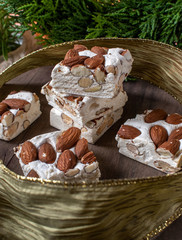 almond nougat bar squares with festive Christmas ribbon and greenery