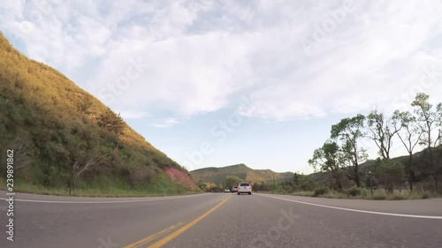 Wall mural Driving on paved road in Boulder area.