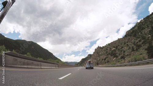 Wall mural Driving on interstate highway in the mountains.