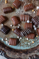 Chocolate candy with drizzle stripes on vintage tray