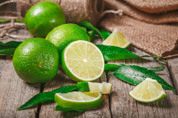 Fresh ripe limes on wood, rich source of Vitamin C, often used to accent of food and beverages