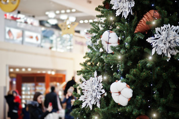 Large New Year tree with decorations in shopping mall.