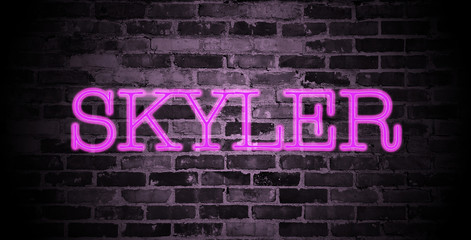 first name Skyler in pink neon on brick wall