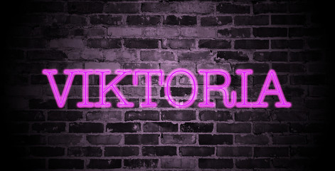 first name Viktoria in pink neon on brick wall