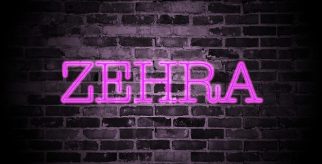 first name Zehra in pink neon on brick wall