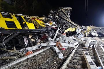 Wall Murals Railroad Massive train derail. Dramatic night scene of a head-on collision between two trains.