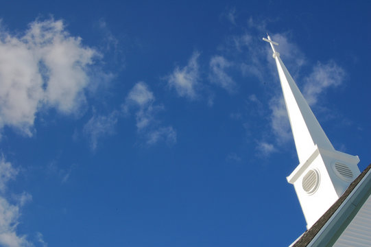 Church steeple with clouds in background