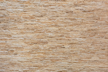 Rosck Stone Brick Tile Wall Texture Background In Light Beige Cream Color. Imitation Of Rough Ancient Stone