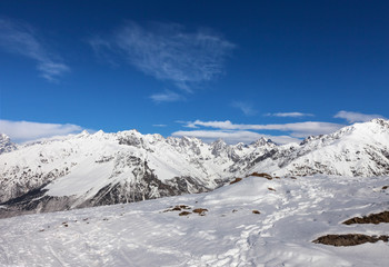 Mountains in snow and beautiful blue sky at sun winter day