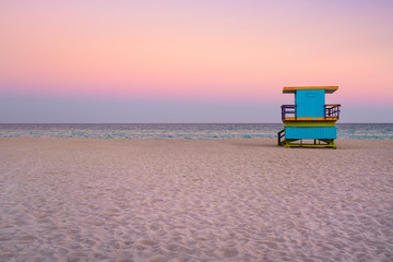 Wall Mural - Famous lifeguard tower at South Beach in Miami with a beautiful sunset sky