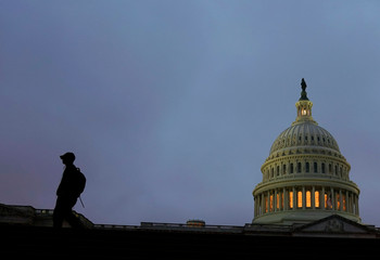 A man walk past the U.S. Capitol ahead of a possible partial government shut down in Washington