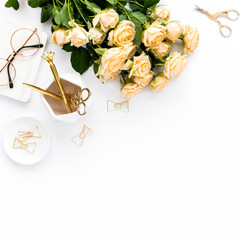 Female workspace with computer, roses flowers bouquet, golden accessories, diary, laptop, glasses on white background. Flat lay women's office desk. Top view feminine background.