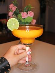 Sharon fruit smoothie shake on margarita glass