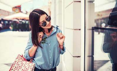 Young woman in shopping looking for presents. Consumerism, fashion, lifestyle concept