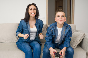 Happy family playing console at home
