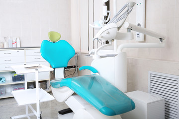 Dentist's office with modern chair and professional equipment