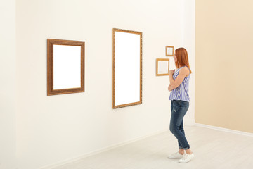 Woman viewing exposition in modern art gallery