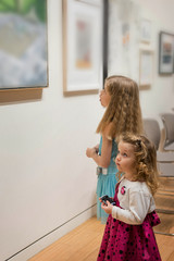 Two little girls are looking at the pictures in the Art Gallery