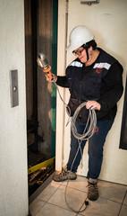 Woman elevator technician